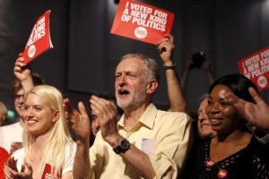 Labour Party leadership candidate Jeremy Corbyn applauds the audience and supporters during a rally in London, Britain September 10, 2015. Britain's opposition Labour Party is voting for a new leader in a contest that polls indicate will be won by Corbyn, a veteran fan of Karl Marx who has upstaged rivals by promising a shift back to the party's socialist roots. REUTERS/Peter Nicholls      TPX IMAGES OF THE DAY      - RTSJJN