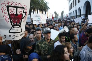 With graphic posters and signs some thousands of Moroccans protest against the death of Mouhcine Fikri last Friday, in the northern city of Hoceima in Rabat, Morocco, Sunday, Oct. 30, 2016.  Crowds of Moroccans are protesting, seemingly incensed by the death of a fisherman crushed to death in a garbage truck. (AP Photo/Abdeljalil Bounhar)