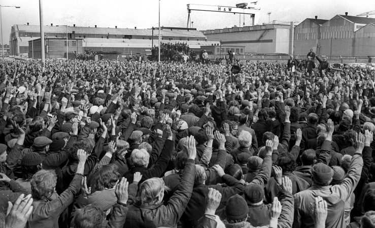 With a show of hands a majority of Belfast, N Ireland's shipyard workers attending a 3rd May 1977 well-supported meeting, vote against supporting the UUAC promoted general strike. The meeting was addressed by shop steward Sandy Scott. 197706030111  Copyright Image from Victor Patterson, 54 Dorchester Park,  Belfast, UK, BT9   t1: +44 28 9066 1296 (from Rep of Ireland 048 90661296) t2: +44 28 9002 2446 (from Rep of Ireland 048 9002 2446)  m: +44 7802 353836  e: victorpatterson@me.com www.victorpatterson.com  Please see my Terms and Conditions of Use at www.victorpatterson.com. It is IMPORTANT that you familiarise yourself with them.  Images used on the Internet must be visibly watermarked i.e. © Victor Patterson within the body of the image and copyright metadata must not be deleted. Images  used on the Internet have a size restriction of 4kbs and will be chargeable at current  NUJ rates unless agreed otherwise.  This image is only available for the use of the download recipient i.e. television station, newspaper, magazine, book publisher, etc, and must not be passed on to any third  party. It is also downloaded on condition that each and every usage is notified within 7 days to victorpatterson@me.com  The right of Victor Patterson to be identified as the author is asserted in accordance with The Copyright Designs And Patents Act (1988). All moral rights are asserted.