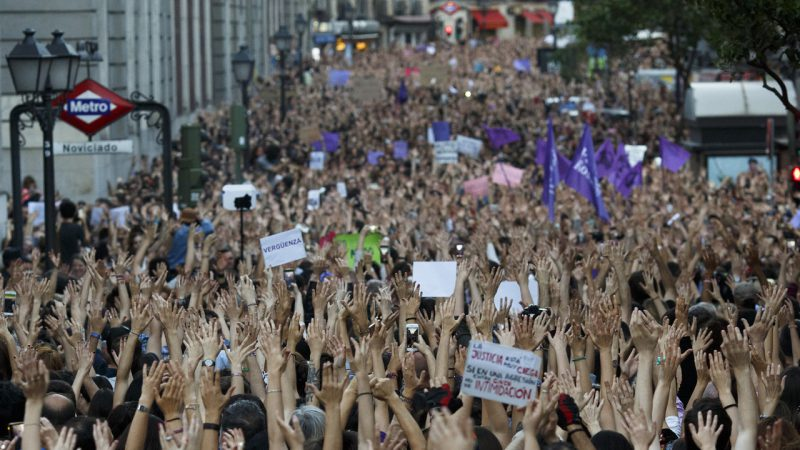 MADRID, SPAIN - APRIL 26:  Protesters raise their hands during a demonstration against the verdict of the 'La Manada' (Wolf Pack) gang case outside the Minister of Justice on April 26, 2018 in Madrid, Spain. The High Court of Navarra has given a sentence of 9 years in prison to five men for 'continued sexual abuse' instead of 'rape', which would have seen them recieve around 22 years in prison. The gang assaulted an 18-year-old woman in Pamplona, during the San Fermin Festival in 2016. Feminists and women's rights groups have called for demonstrations across Spain.  (Photo by Pablo Blazquez Dominguez/Getty Images)