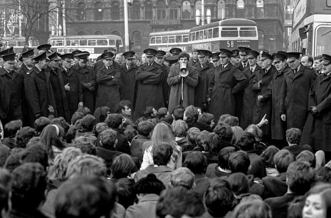 Student sit-down in Donegall Square East, Belfast, N Ireland, as part of the civil rights campaign, the precursor to the N Ireland Troubles. The guy with microphone is Kevin Boyle, who went on to become a university law lecturer. Ref: Student_sit-down_CRA_Campaign_196810160240a.  Copyright Image from Victor Patterson, 54 Dorchester Park,  Belfast, UK, BT9   t1: +44 28 9066 1296 (from Rep of Ireland 048 90661296) t2: +44 28 9002 2446 (from Rep of Ireland 048 9002 2446)  m: +44 7802 353836  e: victorpatterson@me.com www.victorpatterson.com  Please see my Terms and Conditions of Use at www.victorpatterson.com. It is IMPORTANT that you familiarise yourself with them.  Images used on the Internet must be visibly watermarked i.e. © Victor Patterson within the body of the image and copyright metadata must not be deleted. Images  used on the Internet have a size restriction of 4kbs and will be chargeable at current  NUJ rates unless agreed otherwise.  This image is only available for the use of the download recipient i.e. television station, newspaper, magazine, book publisher, etc, and must not be passed on to any third  party. It is also downloaded on condition that each and every usage is notified within 7 days to victorpatterson@me.com  The right of Victor Patterson to be identified as the author is asserted in accordance with The Copyright Designs And Patents Act (1988). All moral rights are asserted.