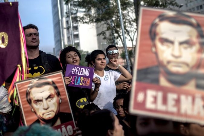 SAO PAULO, BRAZIL - SEPTEMBER 29: Protesters carry posters against the far-right's presidential candidate on September 29, 2018 in Sao Paulo, Brazil. The protests occurred simultaneously in several Brazilian cities, against Jair Bolsonaro, the far right's presidential candidate. Protests included an internet campaign (#elenão and #himnot) which was joined by many women from various countries. Corinthians fans, Brazil's biggest soccer team, and other social groups also joined. (Photo by Victor Moriyama/Getty Images)