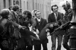 Mandatory Credit: Photo by Daily Mail/REX/Shutterstock (1214404a) Bloody Sunday Riot In Londonderry Northern Ireland Injured Protester Carried By Friends Past Soldiers...  Bloody Sunday Riot In Londonderry Northern Ireland Injured Protester Carried By Friends Past Soldiers...